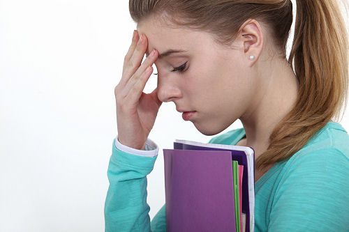 Stressed female teenager worried about exams